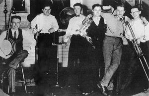 Bix Beiderbecke and his Rhythm Jugglers, 1925, from left to right: Howdy Quicksell (banjo), Tom Gargano (drums), Paul Mertz (piano), Don Murray (clarinet), Bix Beiderbecke (cornet), and Tommy Dorsey (trombone).