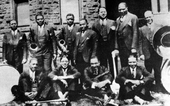 McKinney's Cotton Pickers in 1928. left to right: Cuba Austin, Prince Robinson, George Thomas, Don Redman, Dave Wilborn, Todd Rhoades, Bob Escudero, seated: John Nesbitt, Claude Jones, Milton Senior, Langston Curl. Care of redhotjazz.com